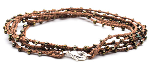 "32"" braided brown silk thread necklace with bronze dorado seed beads and silver plated clasp."