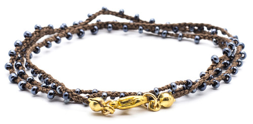 """16"""" braided brown silk thread necklace with hematite seed beads and gold plated clasp."""