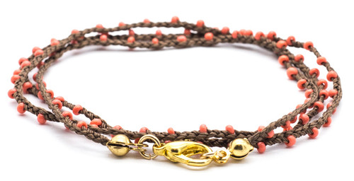 "16"" braided brown silk thread necklace with coral seed beads and gold plated clasp."