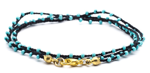 "16"" braided black silk thread necklace with turquoise seed beads and gold plated clasp."