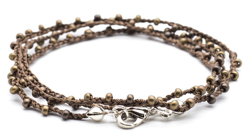 "16"" braided brown silk thread necklace with bronze dorada seed beads and silver plated clasp."