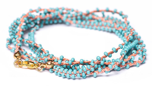 "32"" double braided coral silk thread necklace with turquoise seed beads and gold plated clasp."