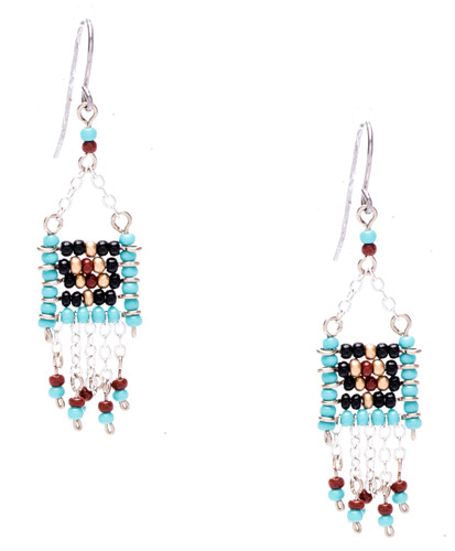 Boho chic, a seductively mix and match of spellbinding turquoise,onyx, gold, mocha seed beads on silver plate finish wire and chain. Surgical steel earwire.