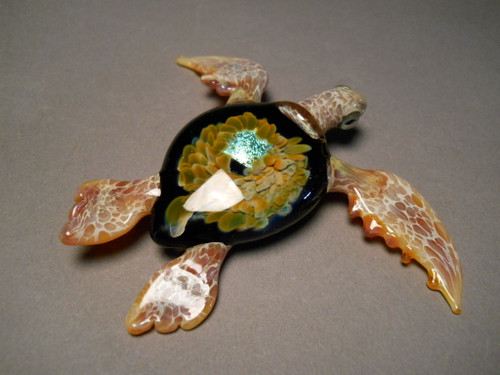 Glass sea turtle with ocean shell