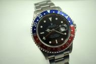 """ROLEX 16710T GMT II ,MINT STAINLESS STEEL """"Z SERIES"""" DATES 2006 PRE-OWNED FOR SALE HOUSTON FABSUISSE"""