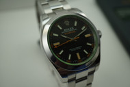ROLEX 116400V MILGAUSS GREEN CRYSTAL ANNIVERSARY w/CARD & BOOKS C.2009 PRE-OWNED FOR SALE HOUSTON FABSUISSE