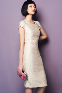light pink  textured dress with a hint of sparkle it has cap sleeves and is knee length
