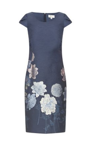blue fitted dress with boat neckline and cap sleeves. This dress has a pretty floral embroidered pattern