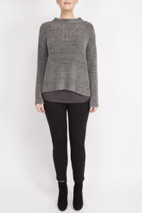 grey jumper with full sleeves and a collar