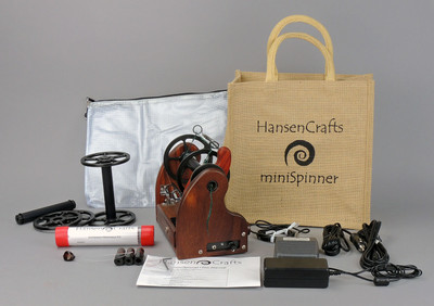 The Ultimate E-Spinner, the HansenCrafts miniSpinner Pro, in Padauk! The Pro includes 2 additional HansenCrafts Standard or 3 additional HansenCrafts Lace bobbins, gear bag, maintenance kit, and orifice reducer set.