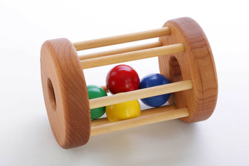 Four brightly colored wooden balls rattle and roll inside a wooden cage. We designed this toy to be bigger than a rattle but still easy for little hands to grasp. Designed to encourage baby to crawl after toy. Also makes a great lap toy for younger babies. Ages: 6 - 18 months. Dimensions: 4 x 5.5 inches. Handcrafted in Oregon, USA.