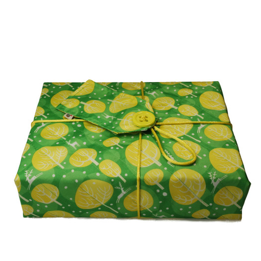 Medium Crackle fabric wrap in Neon Yellow.  Shown wrapping a large hardback cookery book.