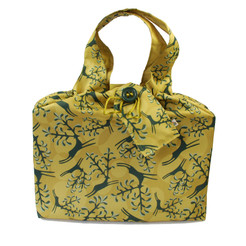 Large fabric Gift Bag in Old Gold.  Shown wrapping example gift.