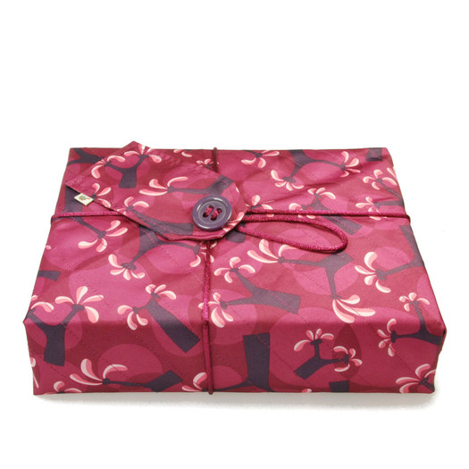 Medium Crackle fabric wrap in Raspberry.  Shown wrapping example gift.