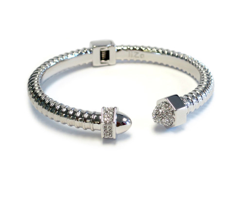 "The Ultra Woman is part of our ""Nut and Bolt"" Collection. Design inspired by the independent and sensual woman. Silver plated accented with Czech Crystals."