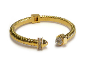 """The Ultra Woman is part of our """"Nut and Bolt"""" Collection. Design inspired by the independent and sensual woman. 18k gold plated accented with Czech Crystals."""