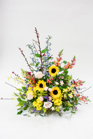 Mixed sympathy tribute with sunflowers and roses