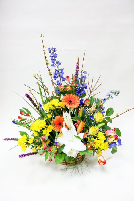 Beautiful bright Sympathy tribute with mixed bold fresh flowers