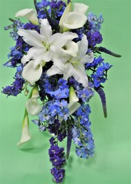 beautiful Blue and White cascading Bouquet designed with Lilies and  a mix of blue fresh flowers