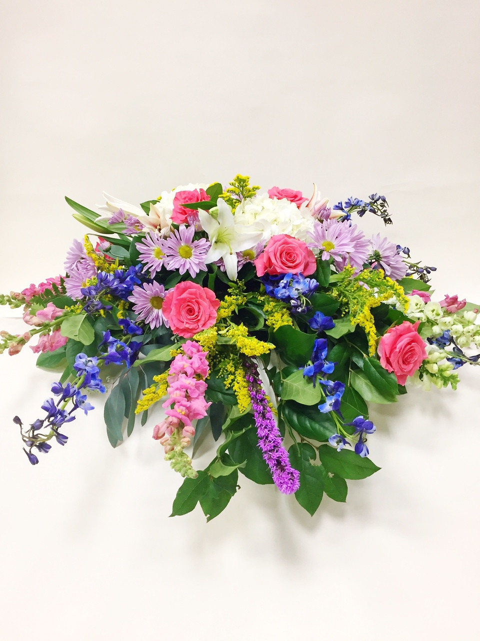 Resting roses casket spray sympathy flowers fresh flowers beautiful fresh flower casket spray designed with pinks purples and whites designed locally izmirmasajfo