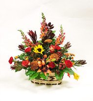 A wonderful arrangement of beautiful fall colors and fresh flowers