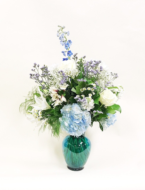 Premium Blue and White mixed vase arrangement designed in a premium blue vase