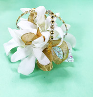 beautiful gold and white corsage with a touch of sparkle.