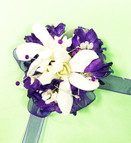 Bold purples mixed with fresh whites dazzled in bling for a stunning fresh flower wrist corsage