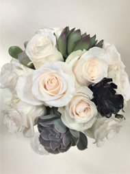 White roses mixed with Succulent Accents in this simple elegant bridal Bouquet