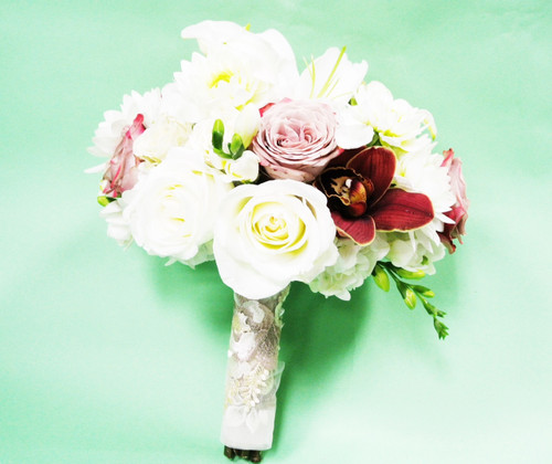 White rose accent bridal bouquet. White roses designed with bright orchids and pale pink roses
