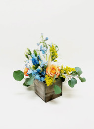 a beautiful rustic character with shades of summer's beauty. Mixed fresh flowers arranged in a rustic box decor!