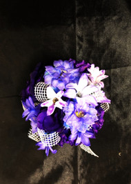 A Beautiful mix of purple hyacinth and other mixed fresh flowers  designs this stunning corsage