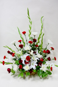Beautiful Traditional Red and White Funeral basket. White Local grown lilies and red carnations arranged with mixed fresh cut flowers and green filler.