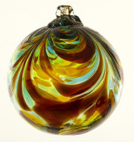 6 inch Kitras Glass Ball in orange and yellow swirl decor.