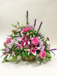 A premium peaceful gaze of local grown Stargazer Lilies in vibrant pink. Beautiful Premium open Garden Roses accented by purple hues of mixed fresh cut flowers and other fillers.
