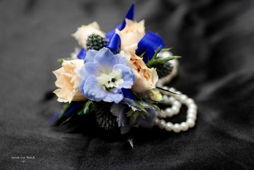 mixed fresh flower corsage on a keepsake bracelet