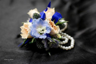 mixed fresh flower corsage on a keepsake bracelet