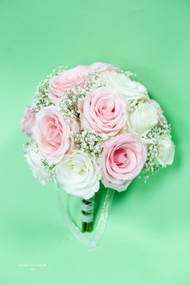 Beautiful Pastel Wedding Bouquet designed with White and Pink Roses.