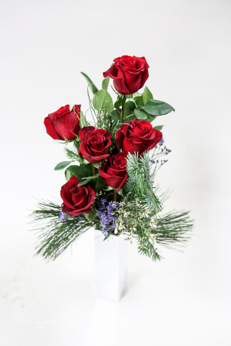 fresh cut half dozen red Christmas roses Fresh Flower Holiday Arrangement- Shop locally at Earle's Loveland Flowers and Gifts.