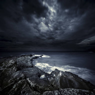 Black Rocks Protruding Through Rough Seas With Stormy Clouds Crete Greece