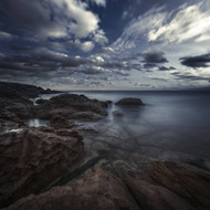 Huge Rocks On The Shore Of A Sea Against A Cloudy Sky Sardinia Italy