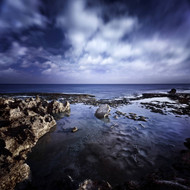Rocky Shore With Tranquil Sea And Cloudy Sky At Sunset Sardinia Italy