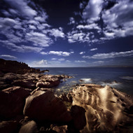 Huge Rocks On The Shore Of A Sea Against Cloudy Sky Sardinia Italy
