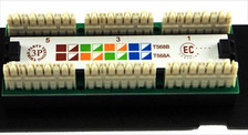 punch down of a 12 port category 5e patch panel
