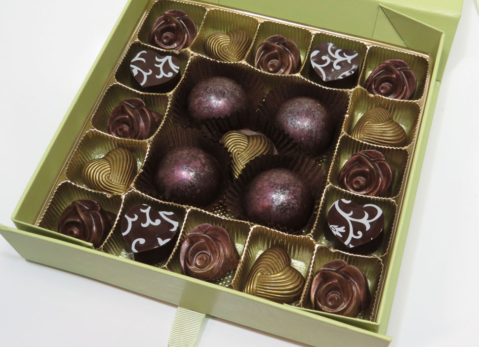 Gourmet Dark Chocolate raspberry filled Roses, Vanilla Bean and chocolate filled Hearts assortment