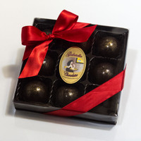 Sea Salt Caramel 9-Piece Gift Box:  Buttery Sea Salt Caramel, fill these beautifully, handcrafted gold speckled chocolates. Made with fresh cream & butter and pure cane sugar.  Encased in a shell of Premium 60% Dark Chocolate.