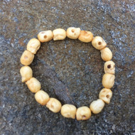Skull Bracelet, 18 Carved Bone Skull Beads on Stretch Cord