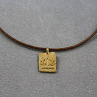 Lotus pendant on leather cord