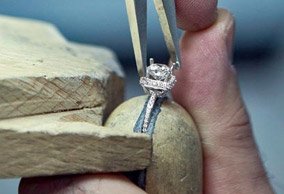 Engagement ring stone tightening