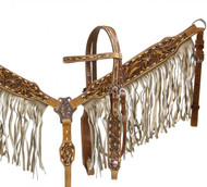 Showman ® double stitched leather headstall and breast collar set with tan suede fringe and floral tooling.